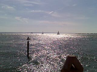 Sunlight on seawater, plus boats